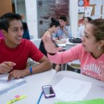 two students working together during class